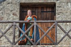 Woman from Europe with medievil clothes from the 14th century. Traditional europe costume. Smederevo, Serbia - May 02, 2019: The Smederevo Fortress is a stock image