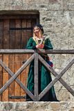 Woman from Europe with medievil clothes from the 14th century. Traditional europe costume. Smederevo, Serbia - May 02, 2019: The Smederevo Fortress is a royalty free stock image