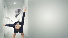 Woman evading flying book Royalty Free Stock Photos