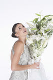 Woman In Evening Dress Accepts Flower Bouquet Royalty Free Stock Photo