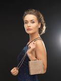 Woman in evening dress. Beautiful woman in evening dress with small bag Stock Image