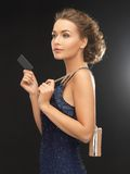 Woman in evening dress. Beautiful woman in evening dress with small bag Royalty Free Stock Photos