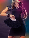 Woman evening dress with black fan in hand Stock Photos