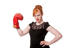 Woman in evening dress with boxing glove. Humorous concept of woman in evening dress wearing boxing glove, isolated on white Stock Photos
