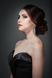 Woman in evening dress. With bright makeup Royalty Free Stock Images