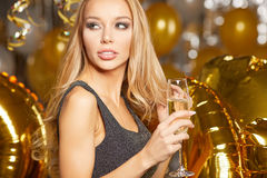 Woman in evening dress with champagne glasses - new year Stock Image