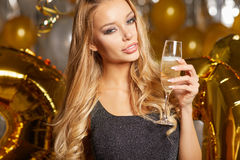 Woman in evening dress with champagne glasses - new year Stock Photography