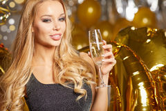 Woman in evening dress with champagne glasses - new year Stock Images
