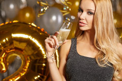 Woman in evening dress with champagne glasses - new year Royalty Free Stock Images