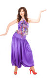 Woman in evening dress dancing Stock Images