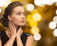 Woman in evening dress and earring Stock Image