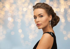 Woman in evening dress and earring Stock Photography