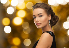 Woman in evening dress and earring Royalty Free Stock Image