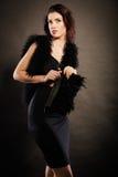 Woman evening dress handbag in hand on black Stock Images