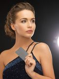 Woman in evening dress with plastic card Royalty Free Stock Image