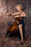 Woman in evening dress playing cello Royalty Free Stock Photo