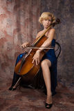 Woman in evening dress playing cello Stock Images