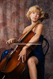 Woman in evening dress playing cello Stock Photos