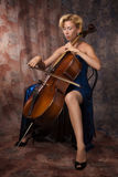 Woman in evening dress playing cello Royalty Free Stock Photos