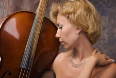 Woman in evening dress posing with cello Stock Photo