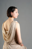 Woman in evening dress sitting Royalty Free Stock Images