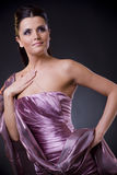 Woman in evening dress with stole Stock Images