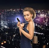Woman in evening dress with vip card Stock Images
