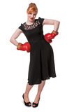 Woman in evening dress wearing boxing glove Royalty Free Stock Photo