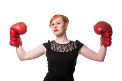 Woman in evening dress wearing boxing glove Royalty Free Stock Photos