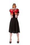 Woman in evening dress wearing boxing glove. Humorous concept of woman in evening dress wearing boxing glove, isolated on white Stock Image