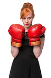 Woman in evening dress wearing boxing glove. Humorous concept of woman in evening dress wearing boxing glove, isolated on white Stock Photography