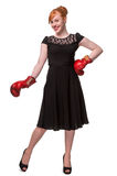 Woman in evening dress wearing boxing glove. Humorous concept of woman in evening dress wearing boxing glove, isolated on white Stock Images