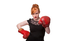 Woman in evening dress wearing boxing glove. Humorous concept of woman in evening dress wearing boxing glove, isolated on white Royalty Free Stock Image