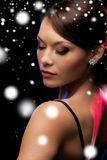 Woman in evening dress wearing diamond earrings Royalty Free Stock Photos