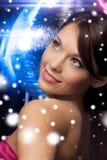 Woman in evening dress wearing diamond earrings Stock Photo