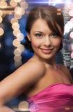 Woman in evening dress wearing diamond earrings Stock Photos