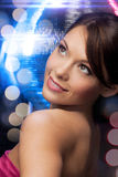 Woman in evening dress wearing diamond earrings Royalty Free Stock Photo