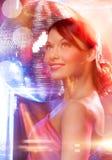 Woman in evening dress wearing diamond earrings Stock Photography