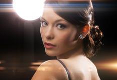Woman in evening dress wearing diamond earrings Stock Image