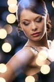 Woman in evening dress wearing diamond earrings Stock Images