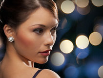 Woman in evening dress wearing diamond earrings Stock Image
