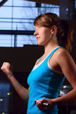 Woman in evening gym Royalty Free Stock Photos