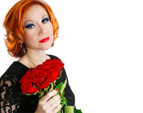 Woman with evening make-up and bouquet of red roses Royalty Free Stock Photos
