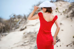 Woman in evening red dress Stock Photos