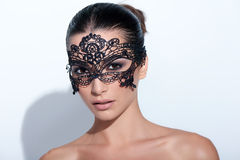 Woman with evening smokey makeup and black lace mask Stock Photos