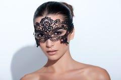 Woman with evening smokey makeup and black lace mask Stock Photos