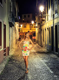 Woman in the evening street Royalty Free Stock Photos