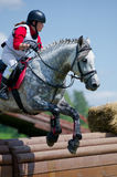 Woman eventer on horse is overcomes the Rolltop Stock Photos