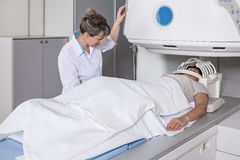 The woman examined her head on the scanner. royalty free stock photo