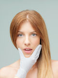 woman examined plastic surgeon scared expression Stock Photos